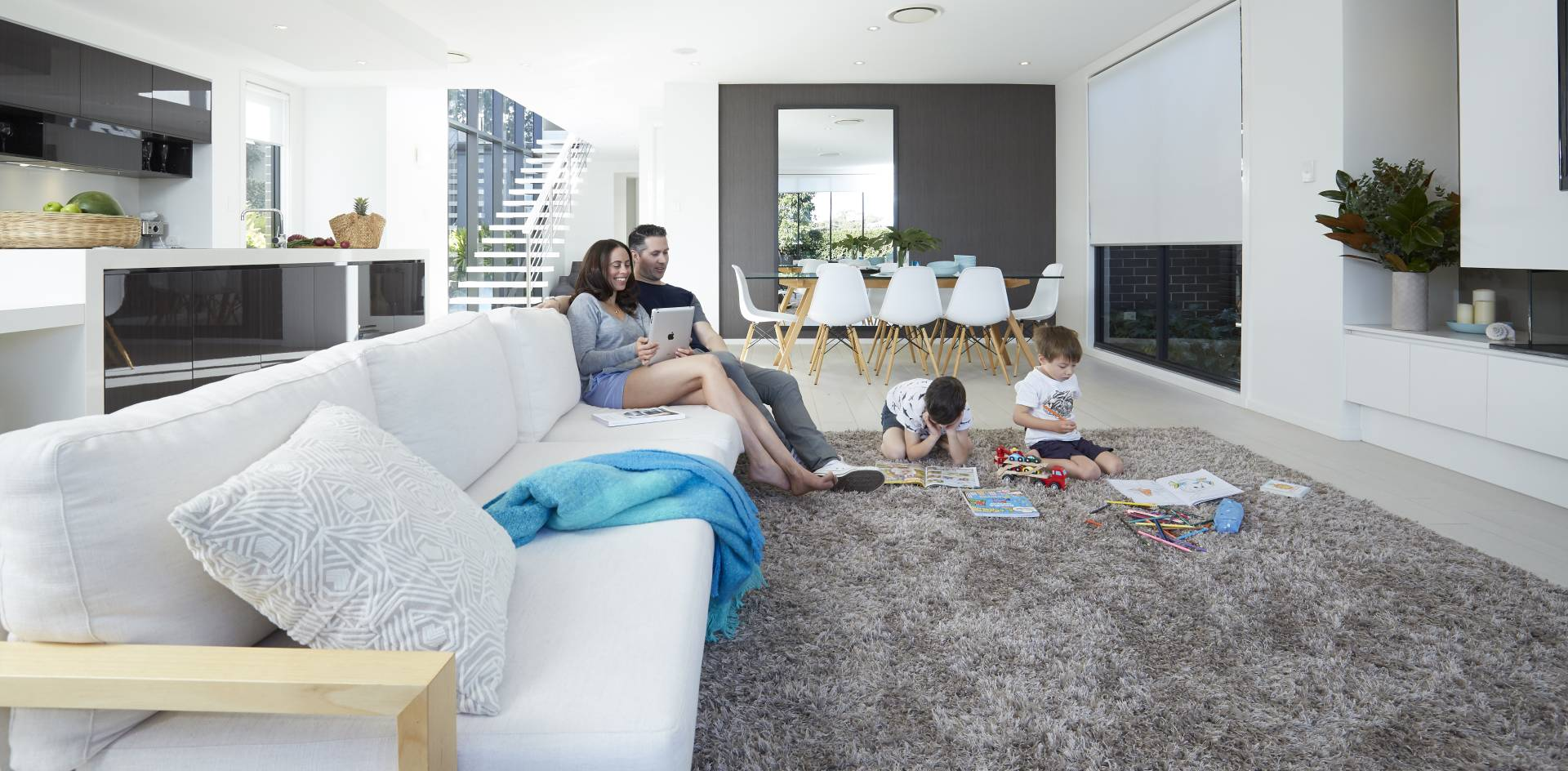 A family of four enjoy their Daikin air conditioning system in their home.